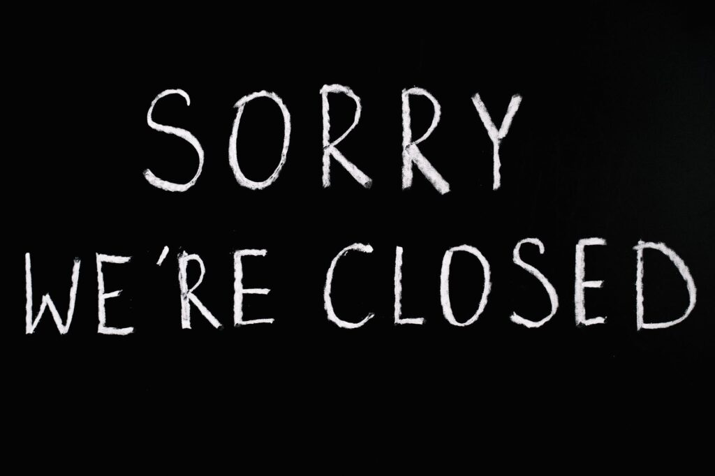 sorry we re closed lettering text on black background